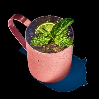 Enjoy a moscow mule drink in a classic copper mug.